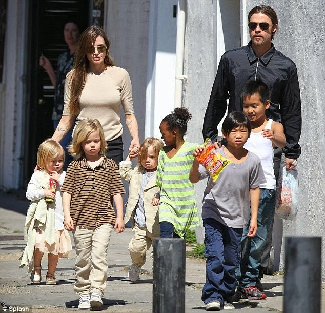 Has Angelina Jolie adopted another child or is this a tribute to Brad Pit tattoo 4